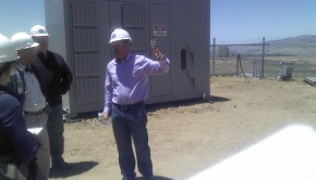 GE Power & Water Wind Products GM Keith Longtin in front of the Brilliant 1.6-100's battery storage bank. Credit: A. Burger/Clean Technica